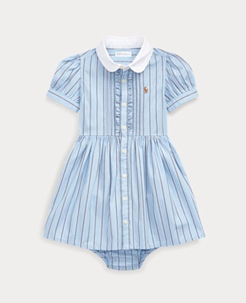 Blue striped shirtdress with puffed short sleeves and white collar.