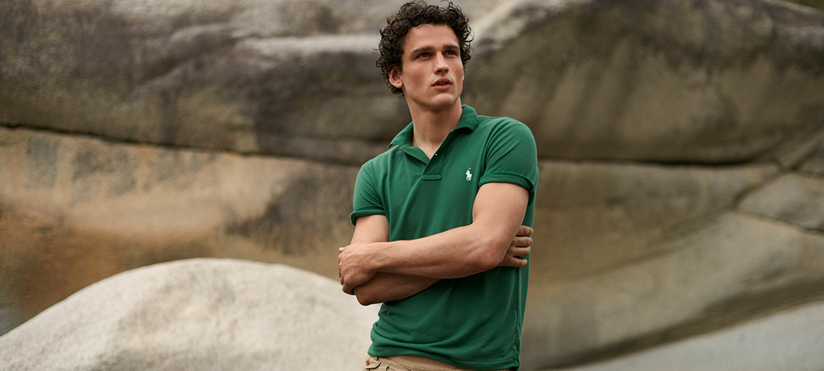 Video of woman & men in white & green Earth Polos