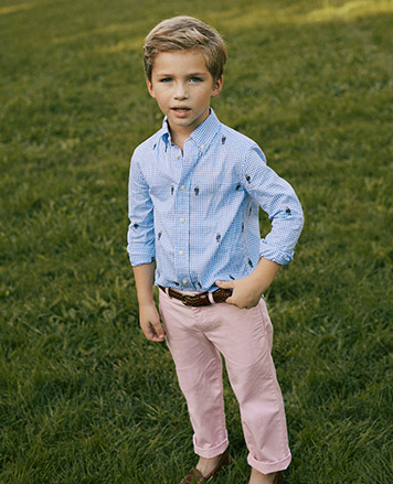 Boy wears blue button-down shirt with embroidered Polo Bears and light-pink pants.