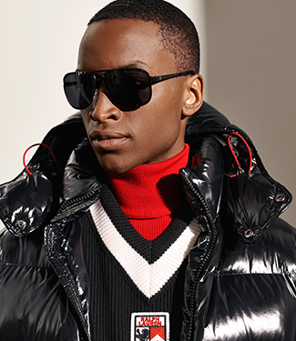 Man in red, white & black graphic long puffer jacket