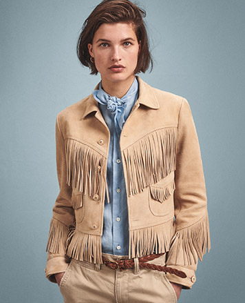 Woman in tan  fringe leather jacket