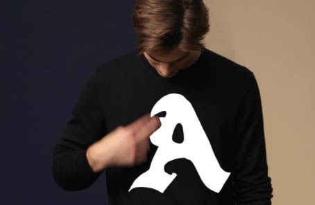Animation of black sweater with custom letter graphics