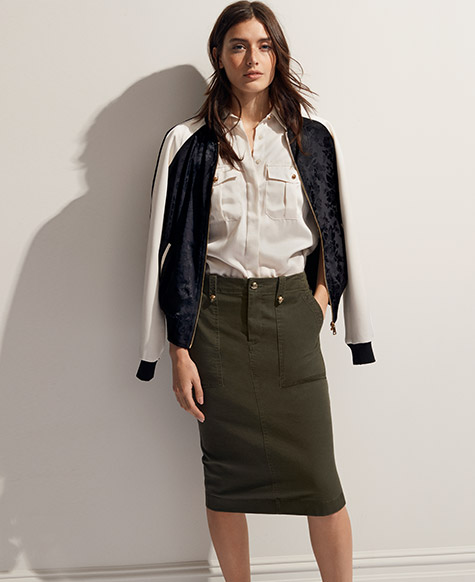 Woman in olive-hued pencil skirt
