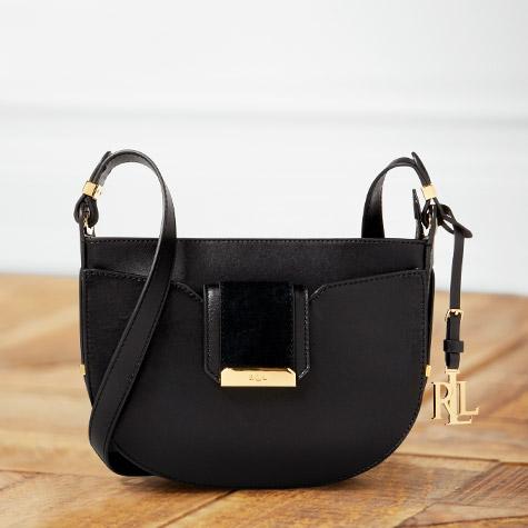 Black leather shoulder bag with fold-over flap closure