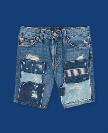 Denim shorts with ripped-and-repaired patches