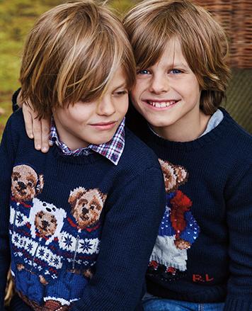 Boys wear sweaters with knit Polo Bear family in après-ski attire.