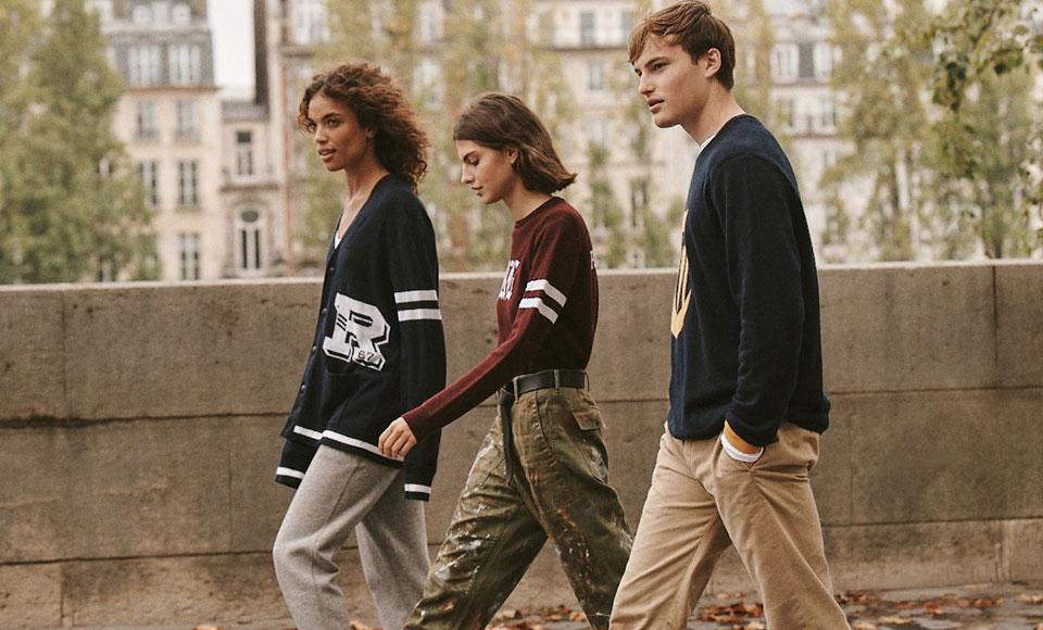Men & women walking down street in custom sweaters