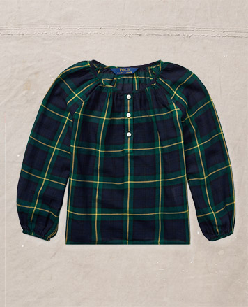 Green and navy plaid shirt with bishop sleeves.