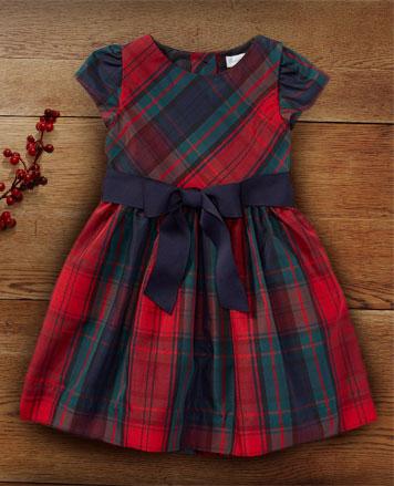 Tartan dress with a navy ribbon sash at the waist..