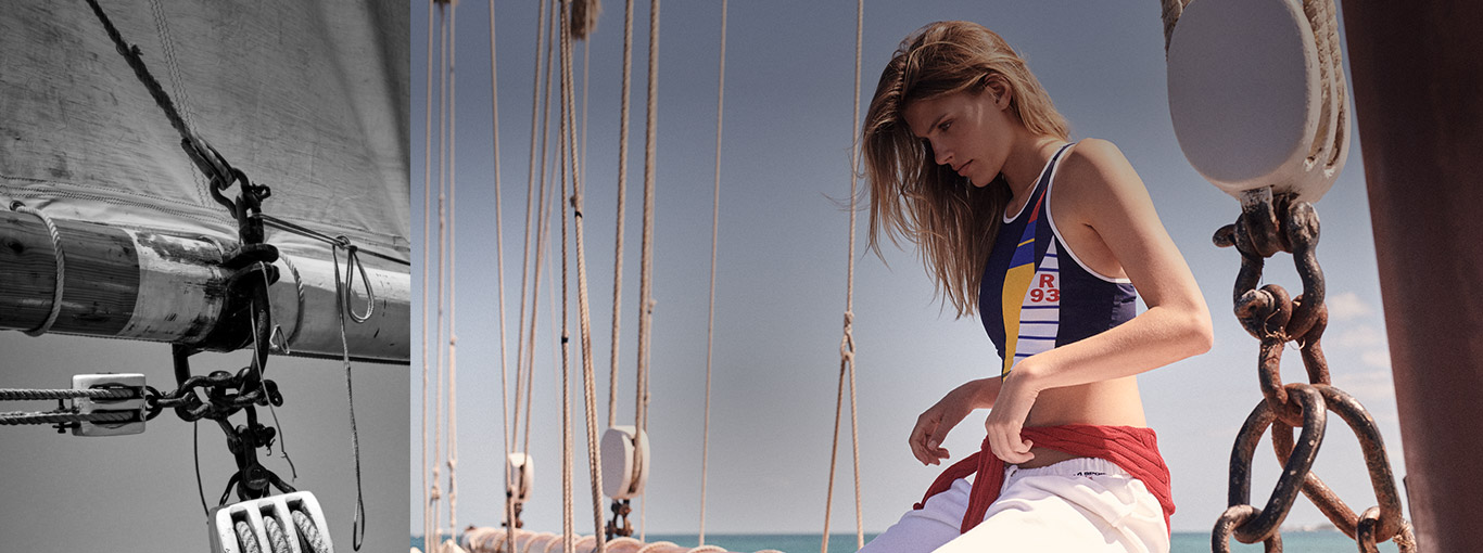 Woman on sailboat and woman in nautical color-blocked crop-top