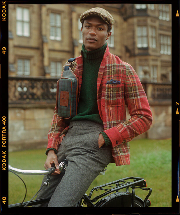 Man in red, green & yellow plaid sport coat layered over turtleneck
