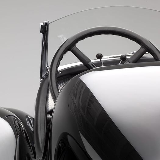 Close-up image of steering wheel & dashboard of vintage car
