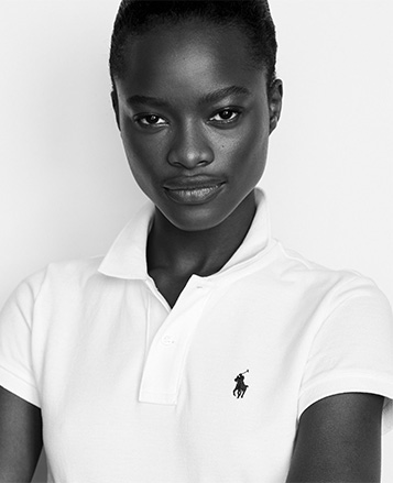 Model in white Polo shirt with embroidered Polo Pony at chest