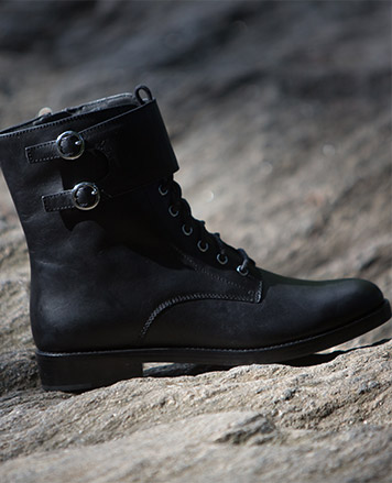 Low black boot with buckled straps