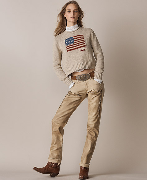 Woman in faded tan pants with beading