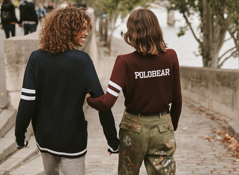 Women walking down street in custom sweaters