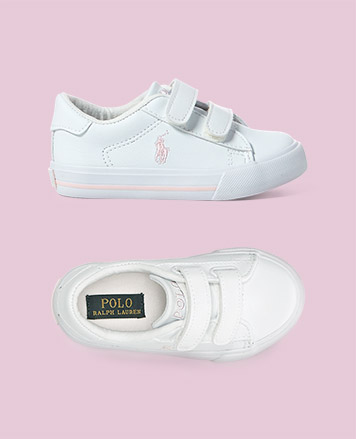 White sneaker with pink signature embroidered pony at the side.