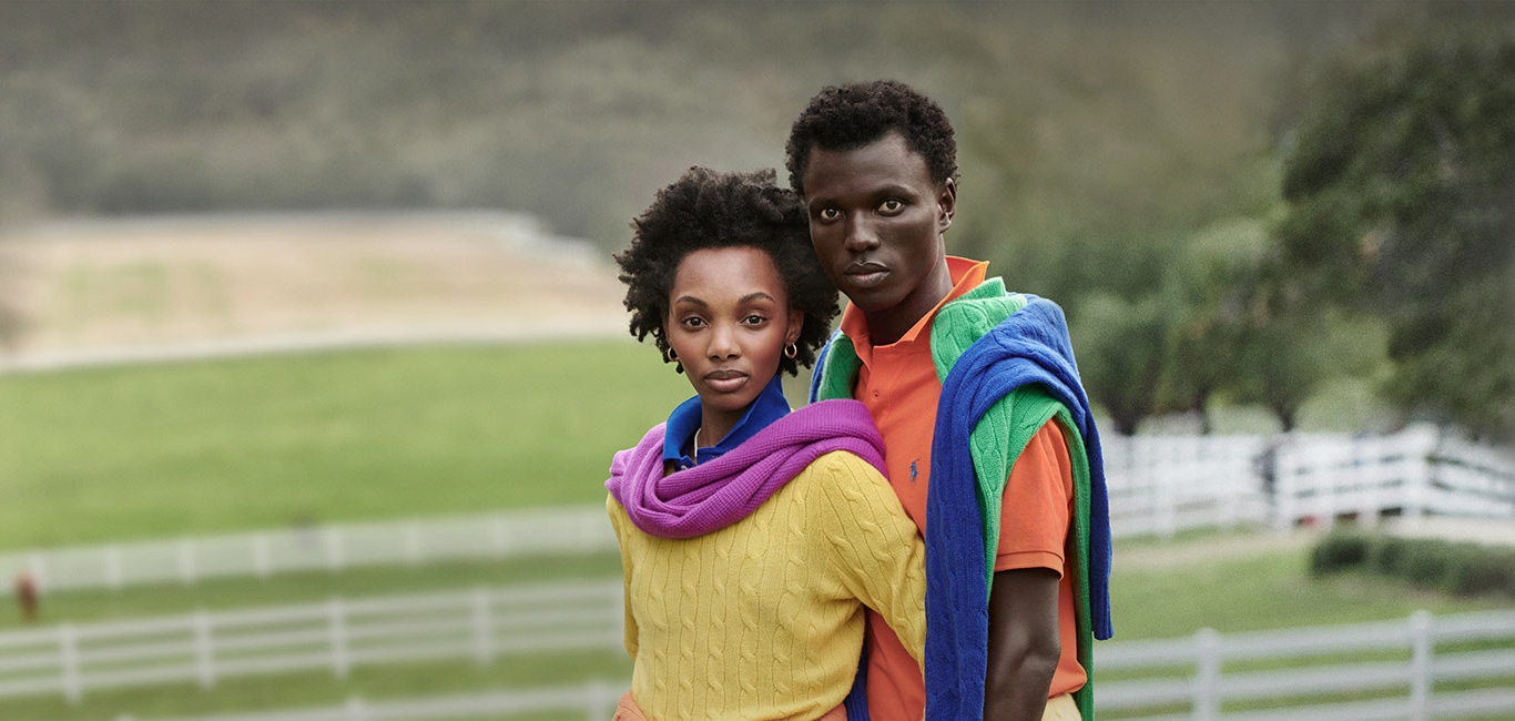 Couple modeling bold-hued cable knits & Polo shirts