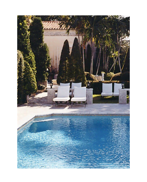 Photograph of luxurious pool area.