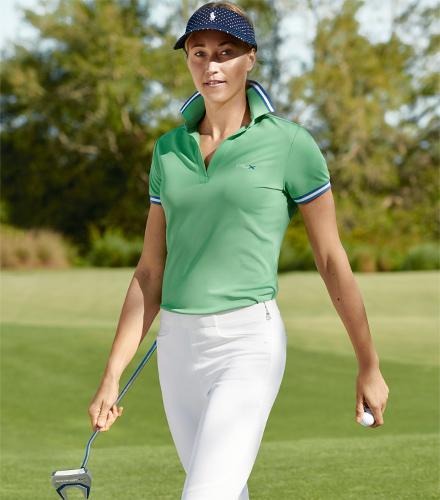 Woman in light green Polo shirt with navy & white trim