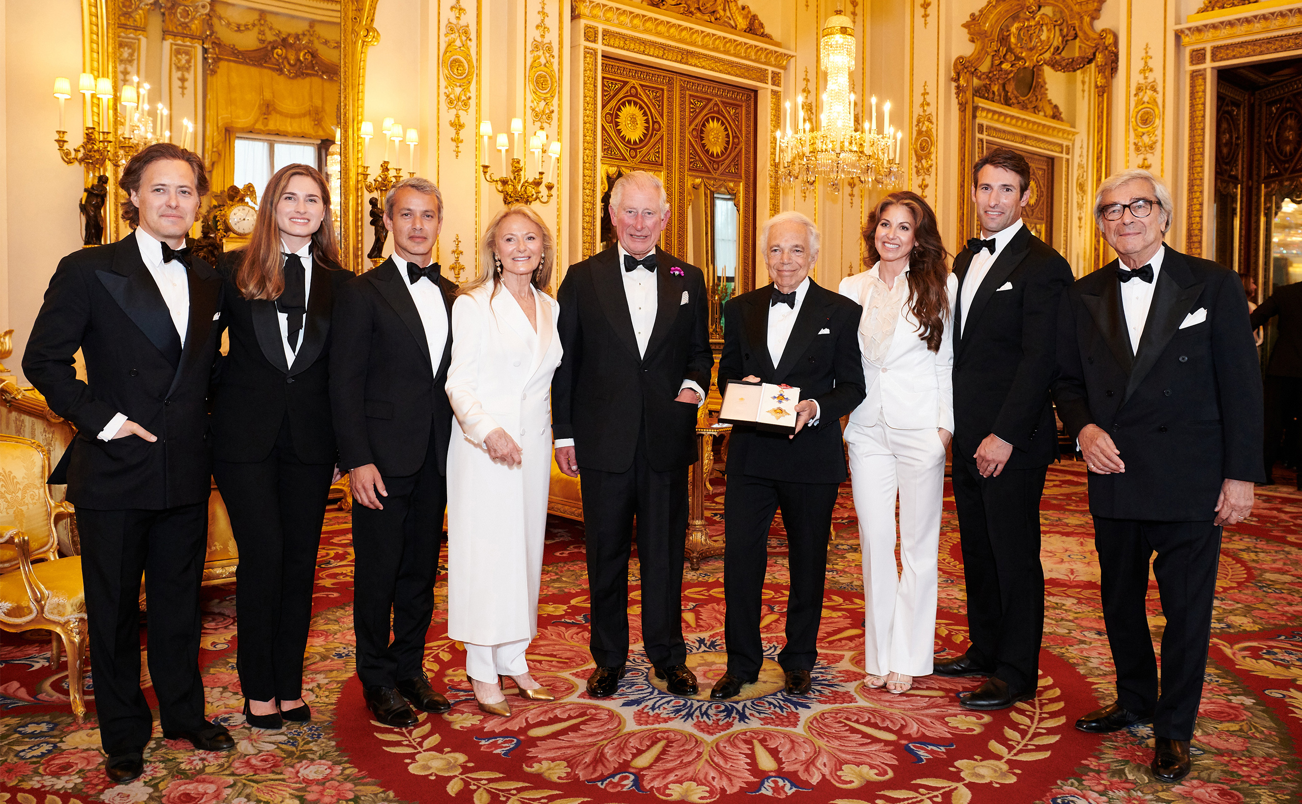 David Lauren, Lauren Bush Lauren, Andrew Lauren, Ricky Lauren, His Royal Highness The Prince of Wales, Ralph Lauren, Dylan Lauren, Paul Arrouet, and Jerry Lauren at Buckingham Palace.