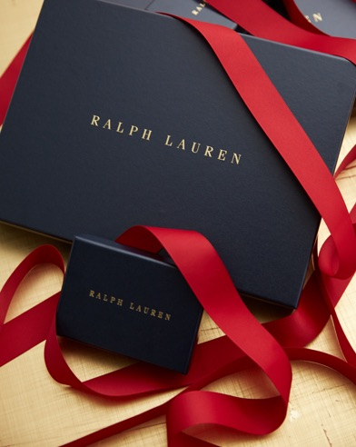Navy gift boxes decorated with red ribbon