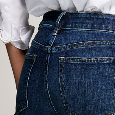 Close-up of back of light-wash ultimate stretch jeans
