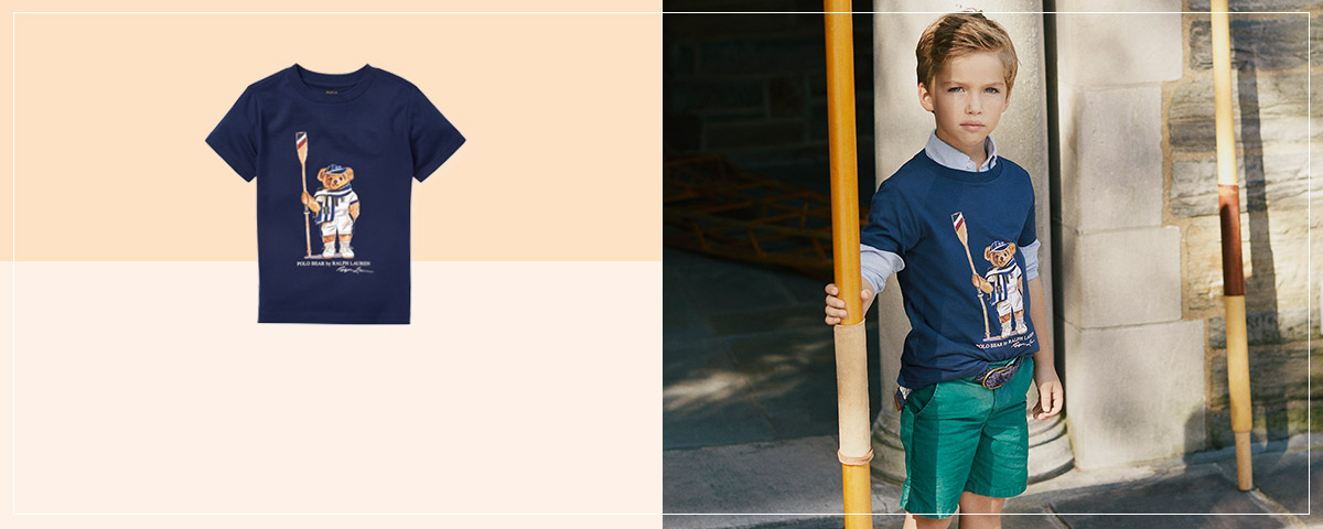Boy wears navy T-shirt with Rowing Bear at the front.