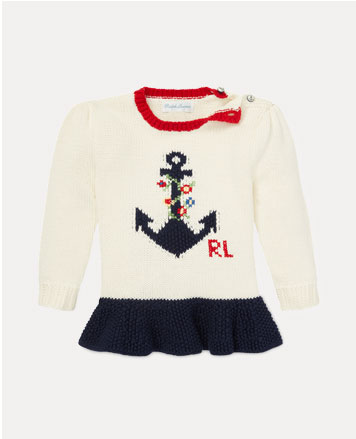 White sweater with intarsia-knit anchor at the front.