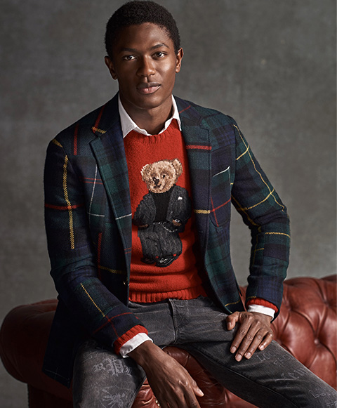 Man in tartan blazer layered over red Polo Bear sweater