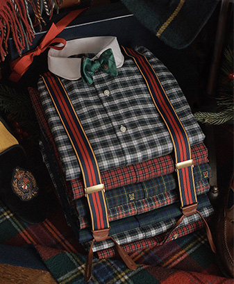 Plaid dress shirts in neat folded stack secured by suspenders