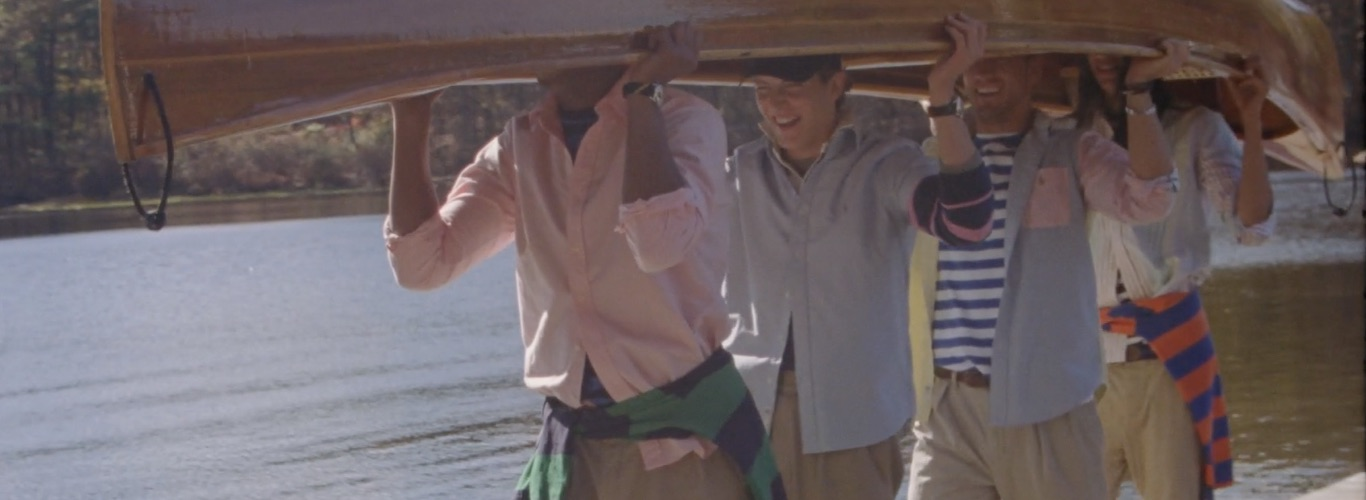 Video of models in Polo attire on dock and on cabin porch.