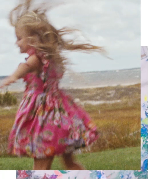 Girl twirls in pink floral dress