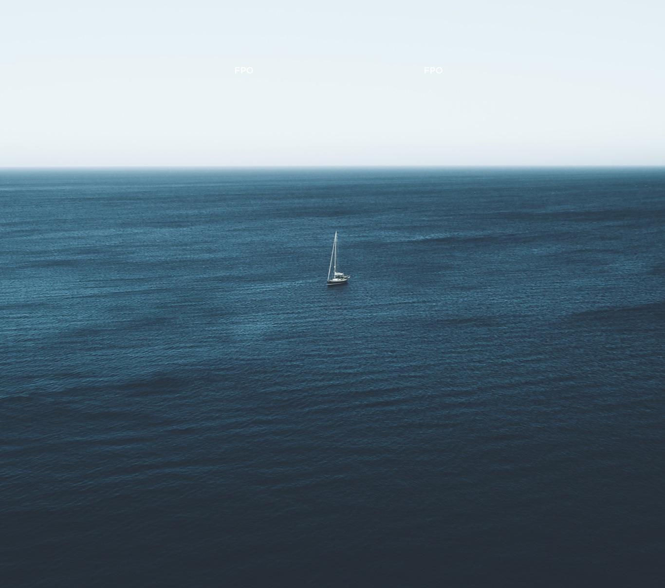 Aerial photograph of sailboat in ocean