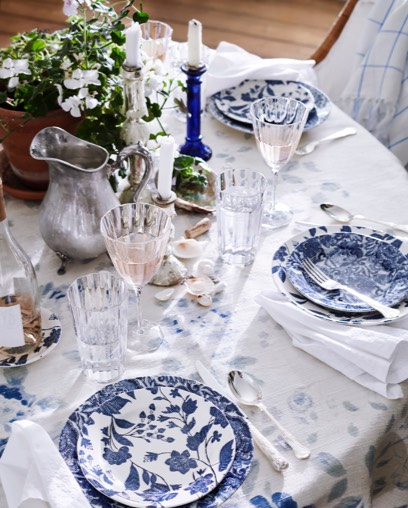 Plate settings with matching blue vine pattern