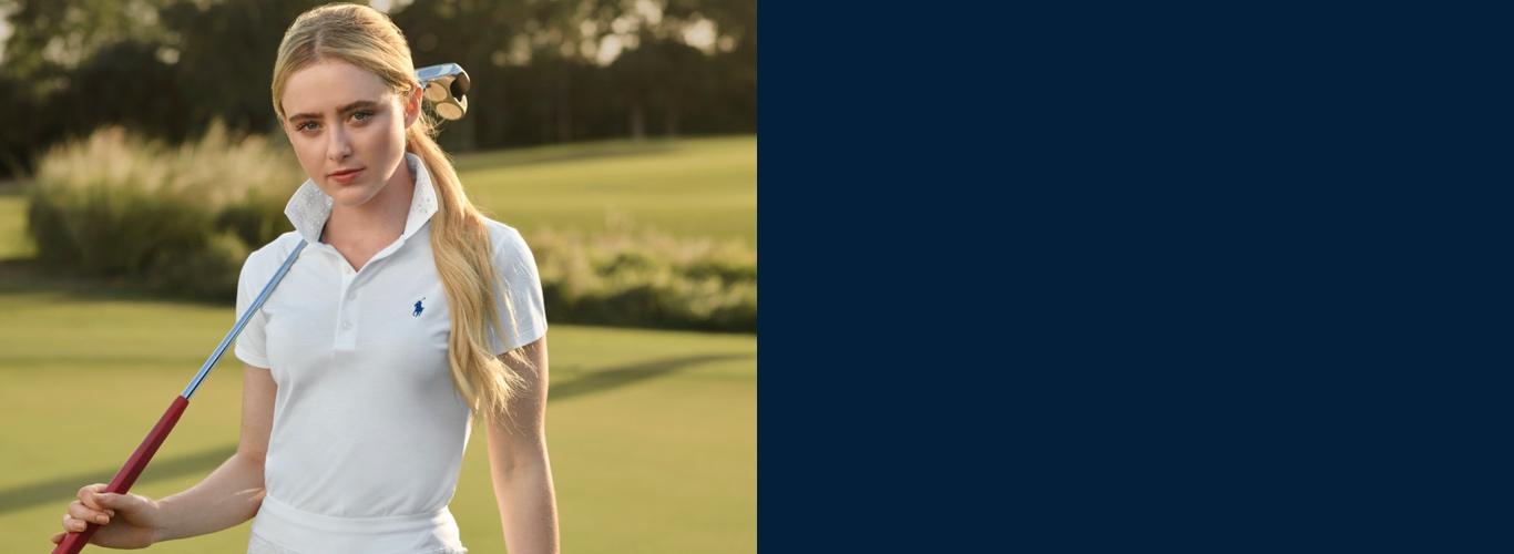 Kathryn Newton in white golf Polo & skort