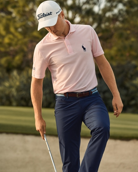 Man in navy chinos on golf course