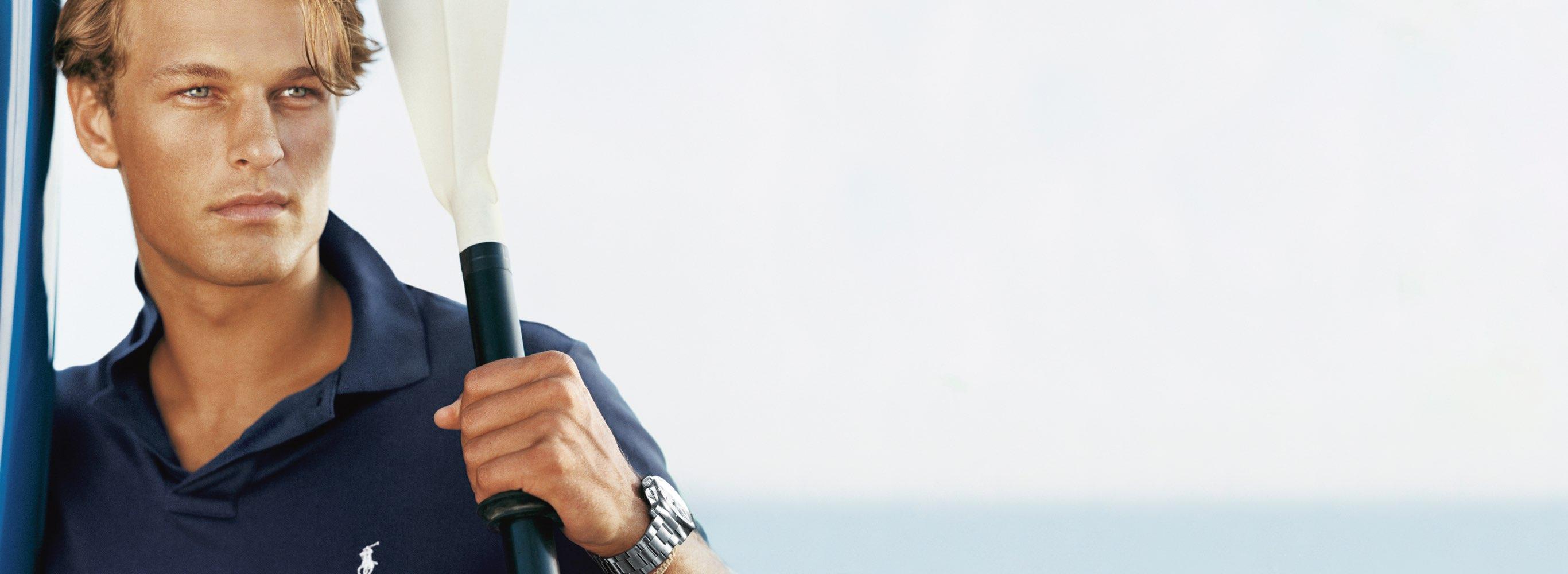 Man in navy blue Polo shirt