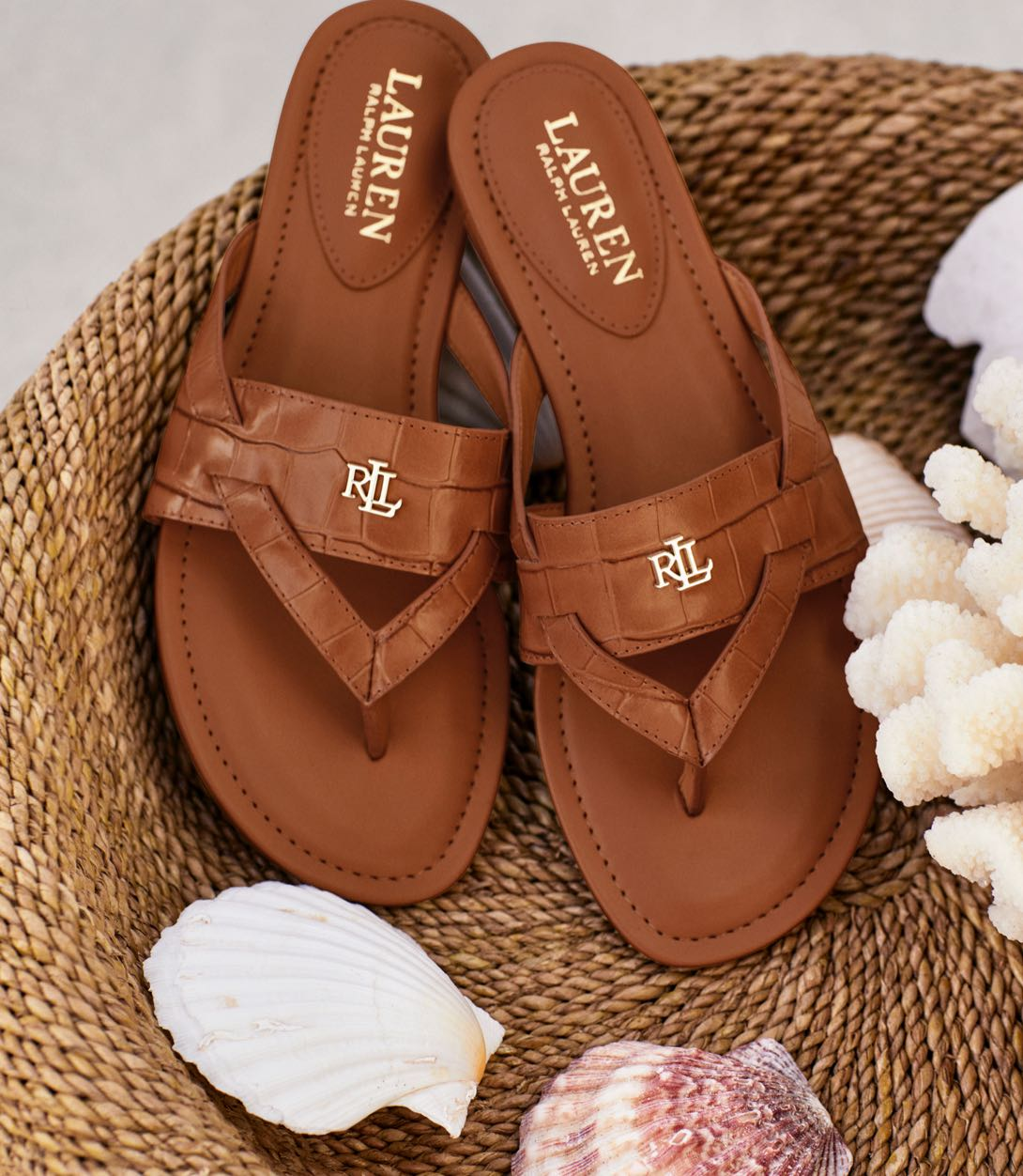 Tan leather thong sandals.