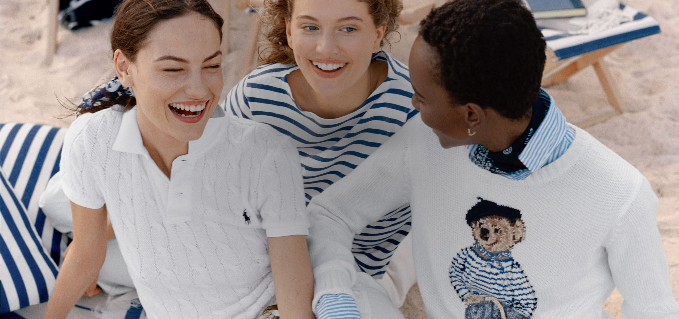 Three women on beach in classic Polo styles