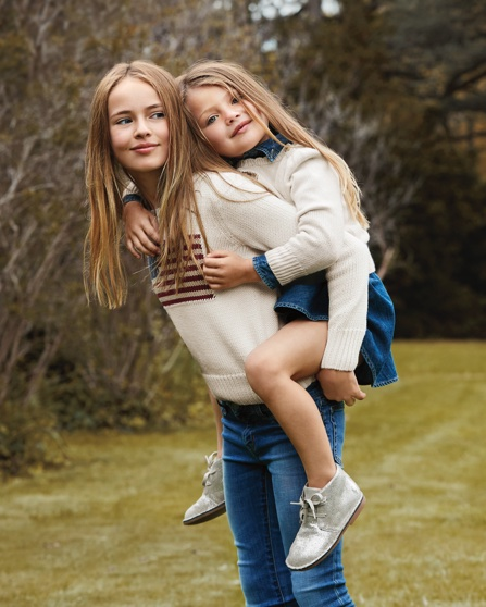 Girls wears denim paired with cream sweaters.