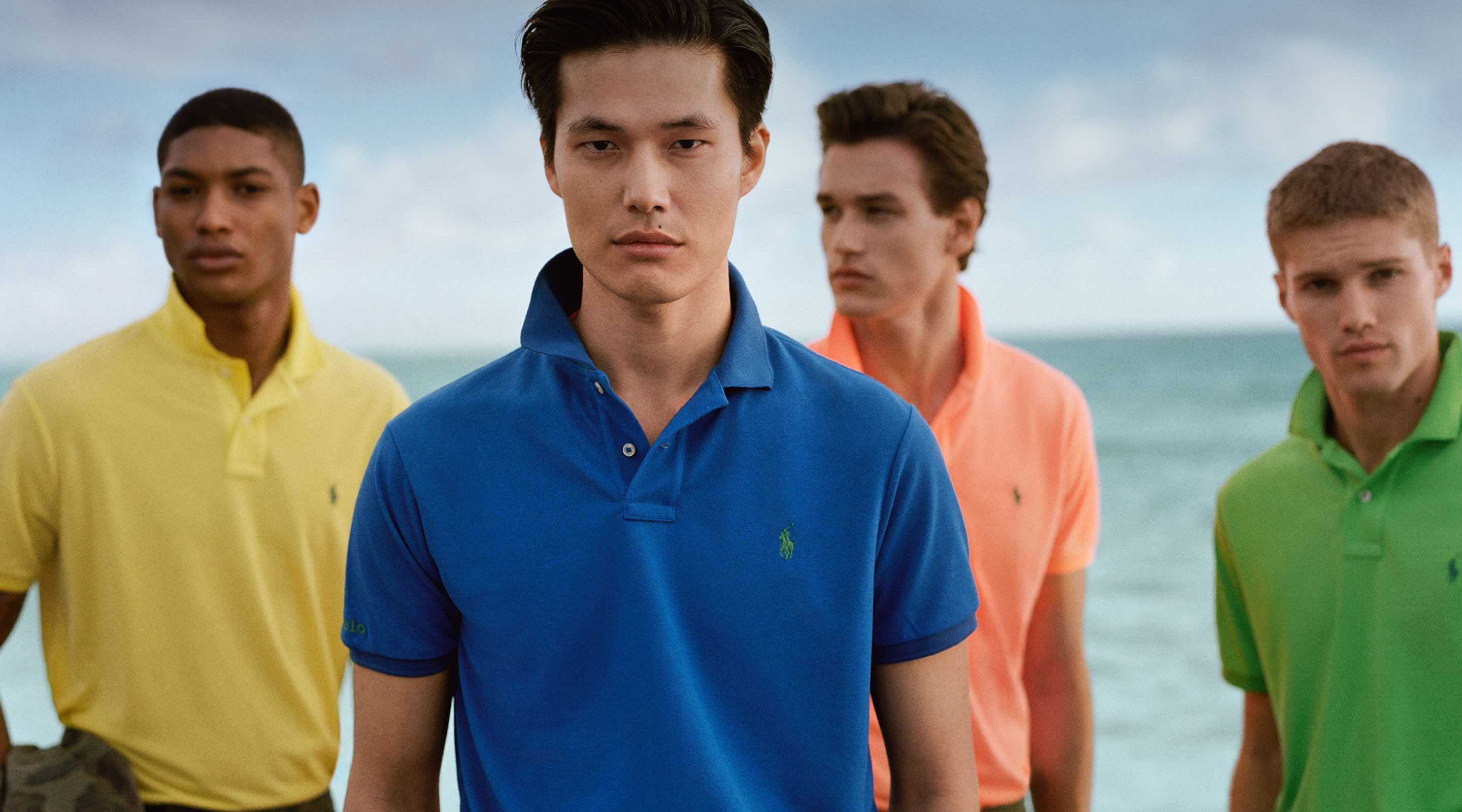 Men in colorful Polo shirts by the ocean