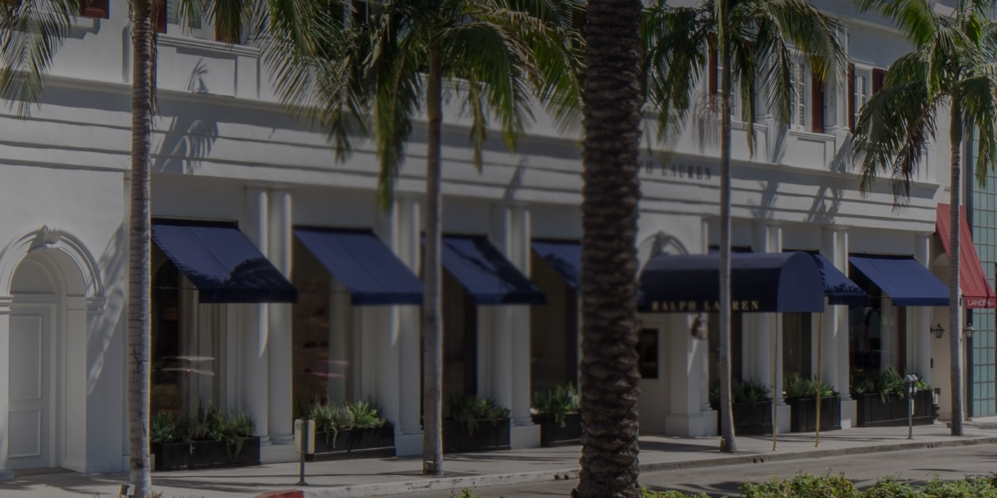 White façade of Beverly Hills flagship store with blue awnings