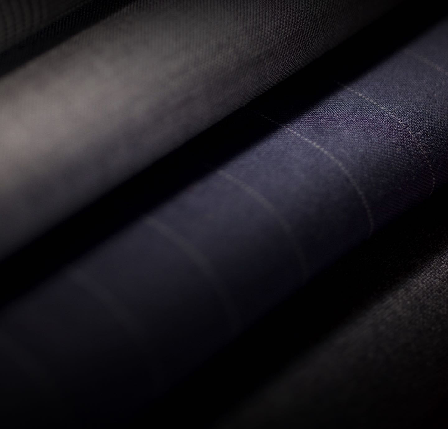 Close-up of navy pinstripe fabric