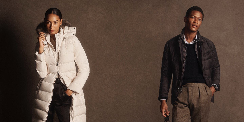 Woman in white puffer jacket & man in dark brown jacket