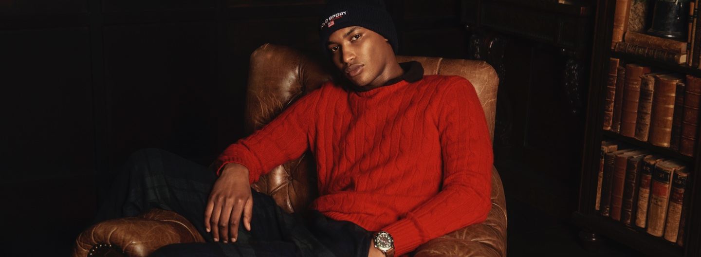 Man in red cable-knit sweater & Polo Sport cap