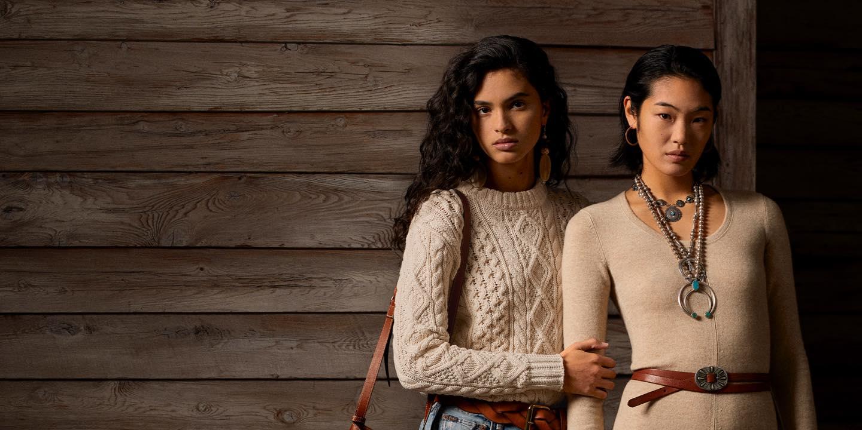 Women in cream sweater & woman in light tan dress