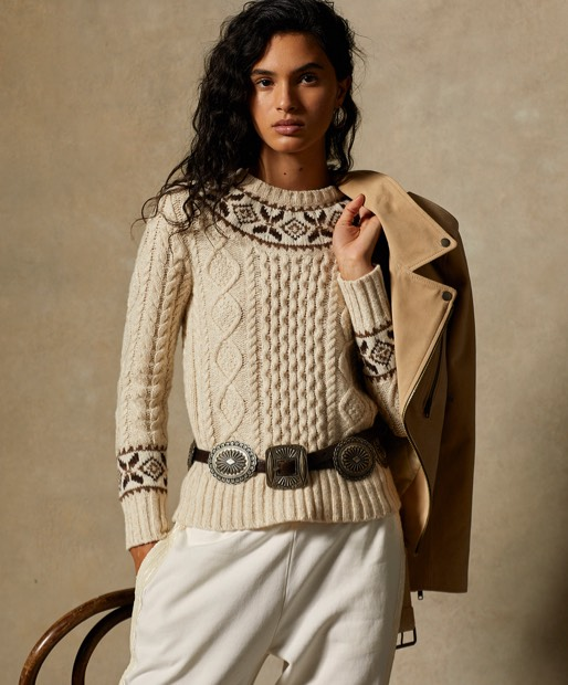 Woman wears aran-knit crewneck sweater with Fair Isle accents