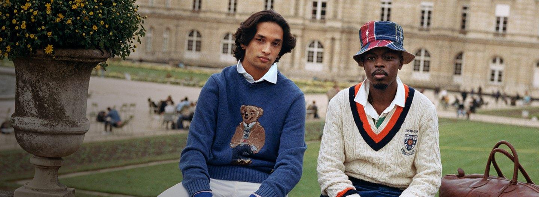 Man in blue Polo Bear sweater & man in cricket sweater