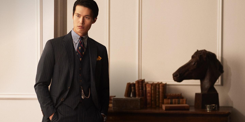 Man in 3-piece pinstripe suit & tie